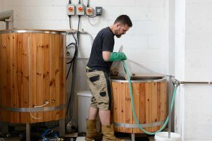 Husk Brewing, brewing in progress in a large wooden tank