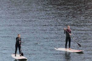 Wakeup Docklands, two paddleboarders