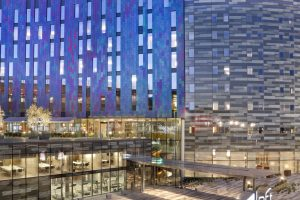 Aloft hotel exterior.  It looks like a blue wave made of glass