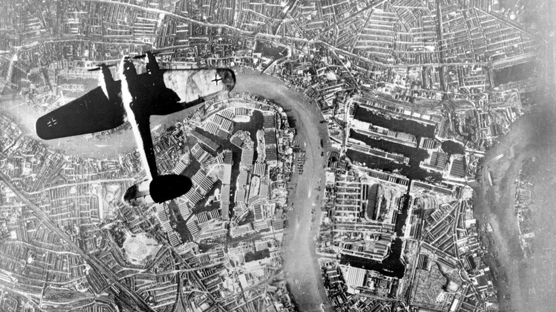 Old photo shot from the air of a plane above the river thames
