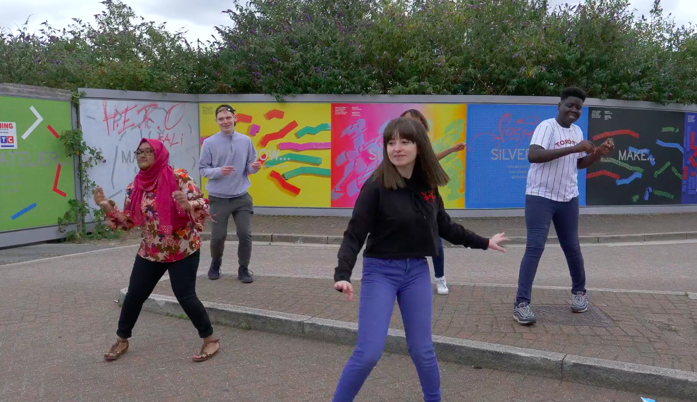 Five young people dancing
