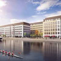 CGI impression of office blocks next to the water with retail on the ground floor