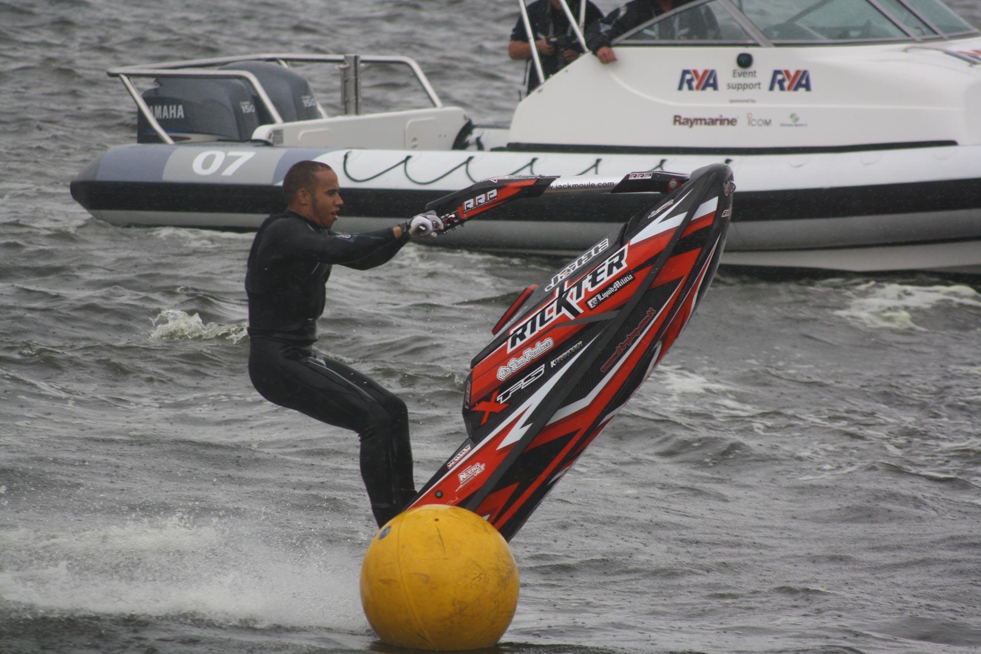 Lewis Hamilton on a jet ski in the Royal Docks