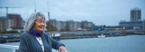 Marian Phillips on a bridge overlooking the Royal Docks