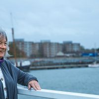 Marian Phillips on a bridge overlooking the Royal Docks