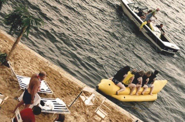 Group of people riding a banana boat in the Royal Docks