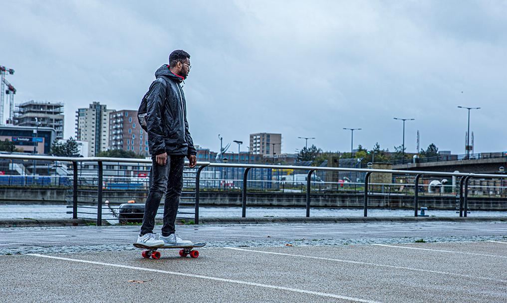 Tyrone Ferguson on a skateboard in the Royal Docks