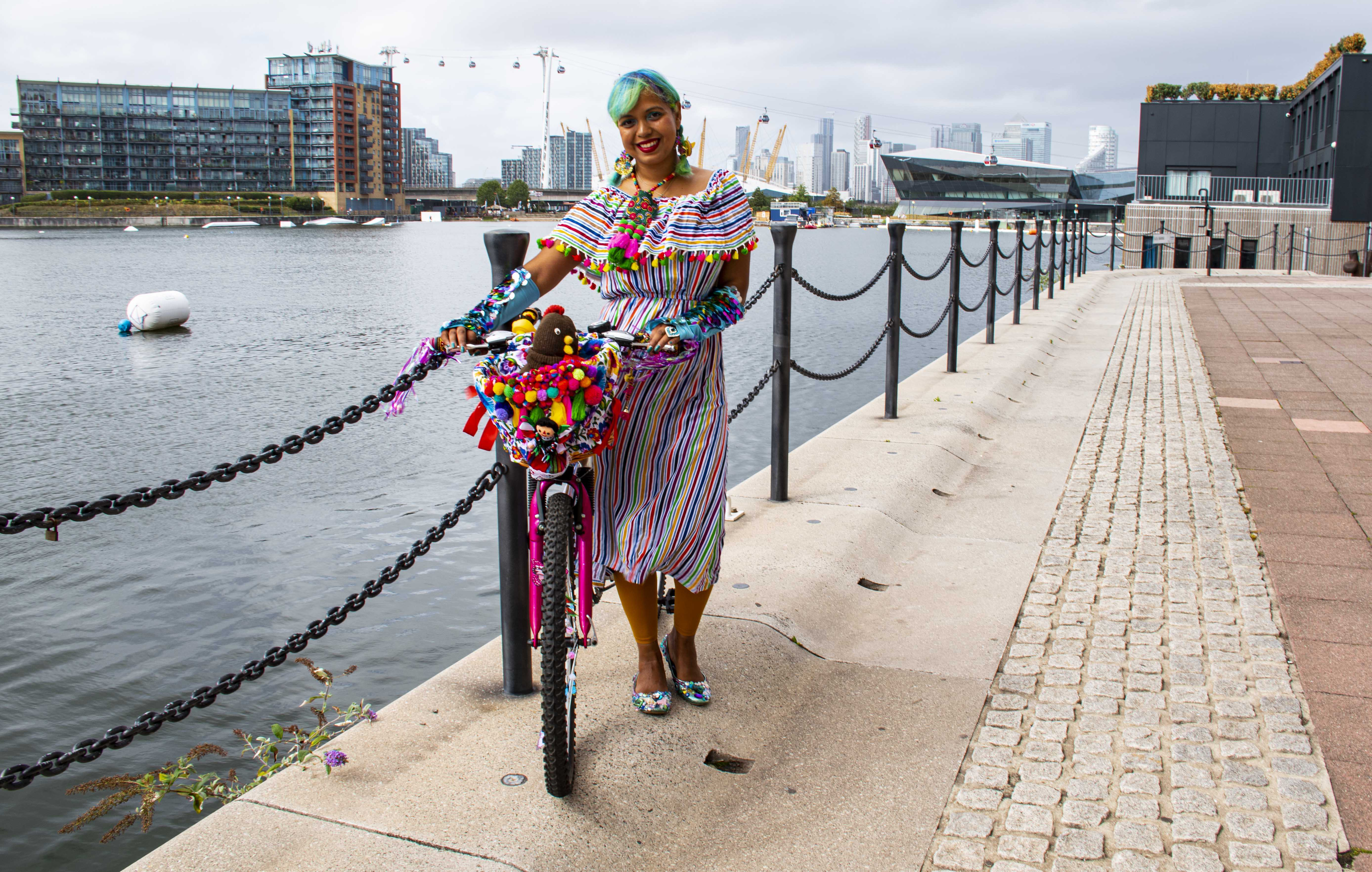 Momtaz with her bike at the Royal Docks