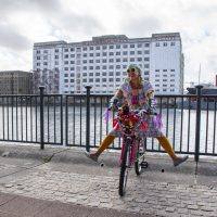 Momtaz in front of Millennium Mills