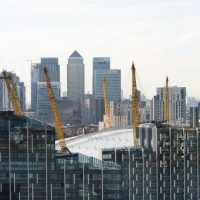 An image of Canary Wharf with The O2 in the foreground