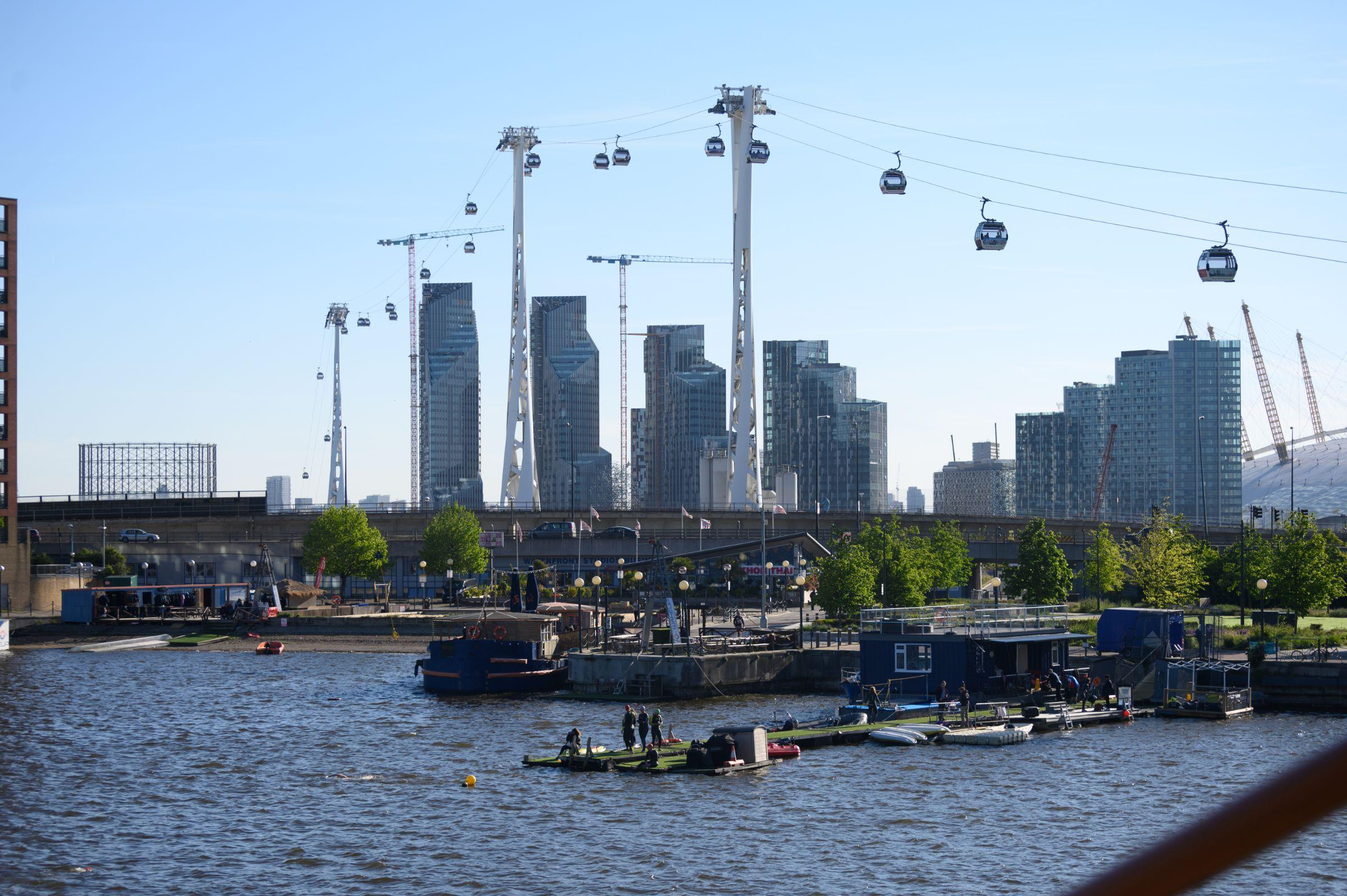 The water at the Royal Docks with the Emirates Cable Car in the background