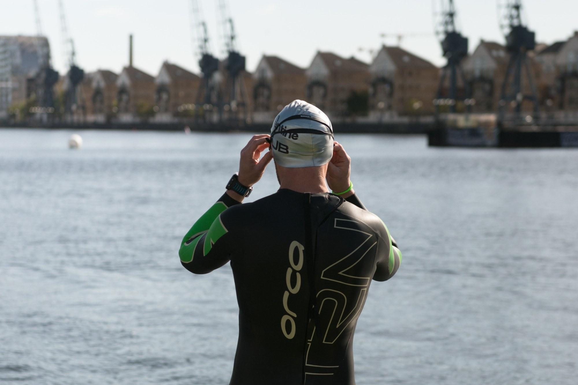 Person in swimming gear looking out at the dock