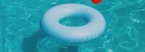 A white rubber ring in a pool