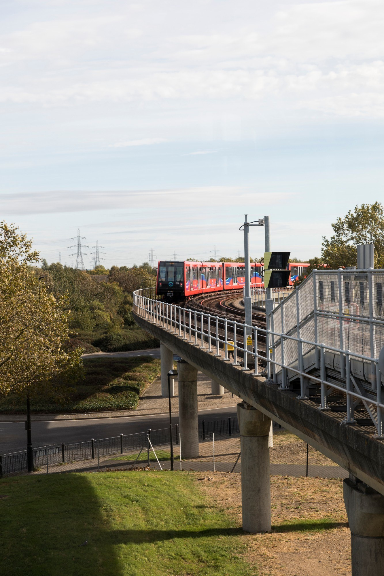 DLR train moving along tracks in the Royal Docks