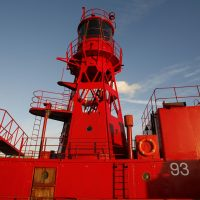 Red lighthouse tower on boat