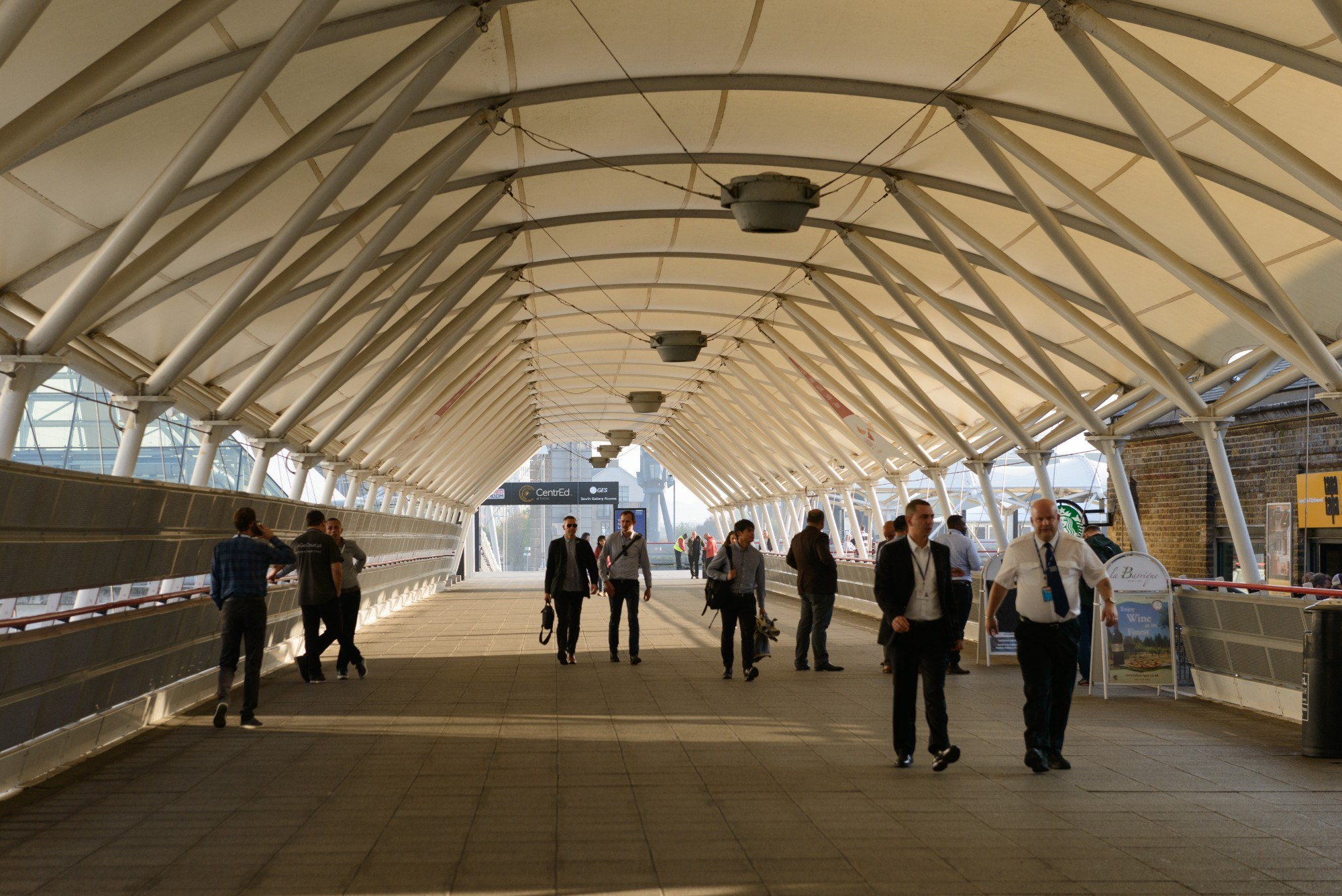 Covered walking leading from Custom House DLR to the ExCeL centre with a translucent canopy.