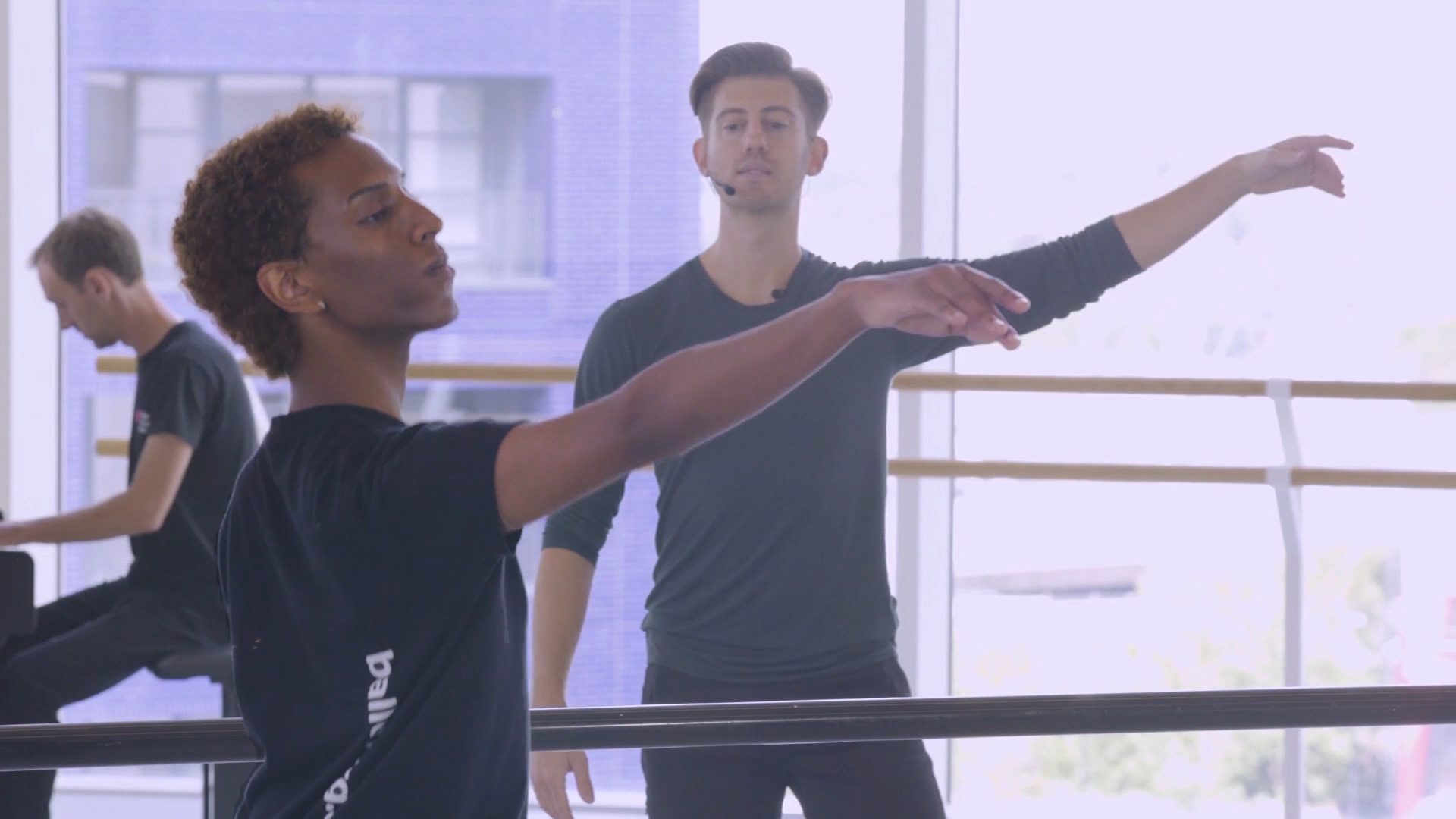 Three people practising ballet