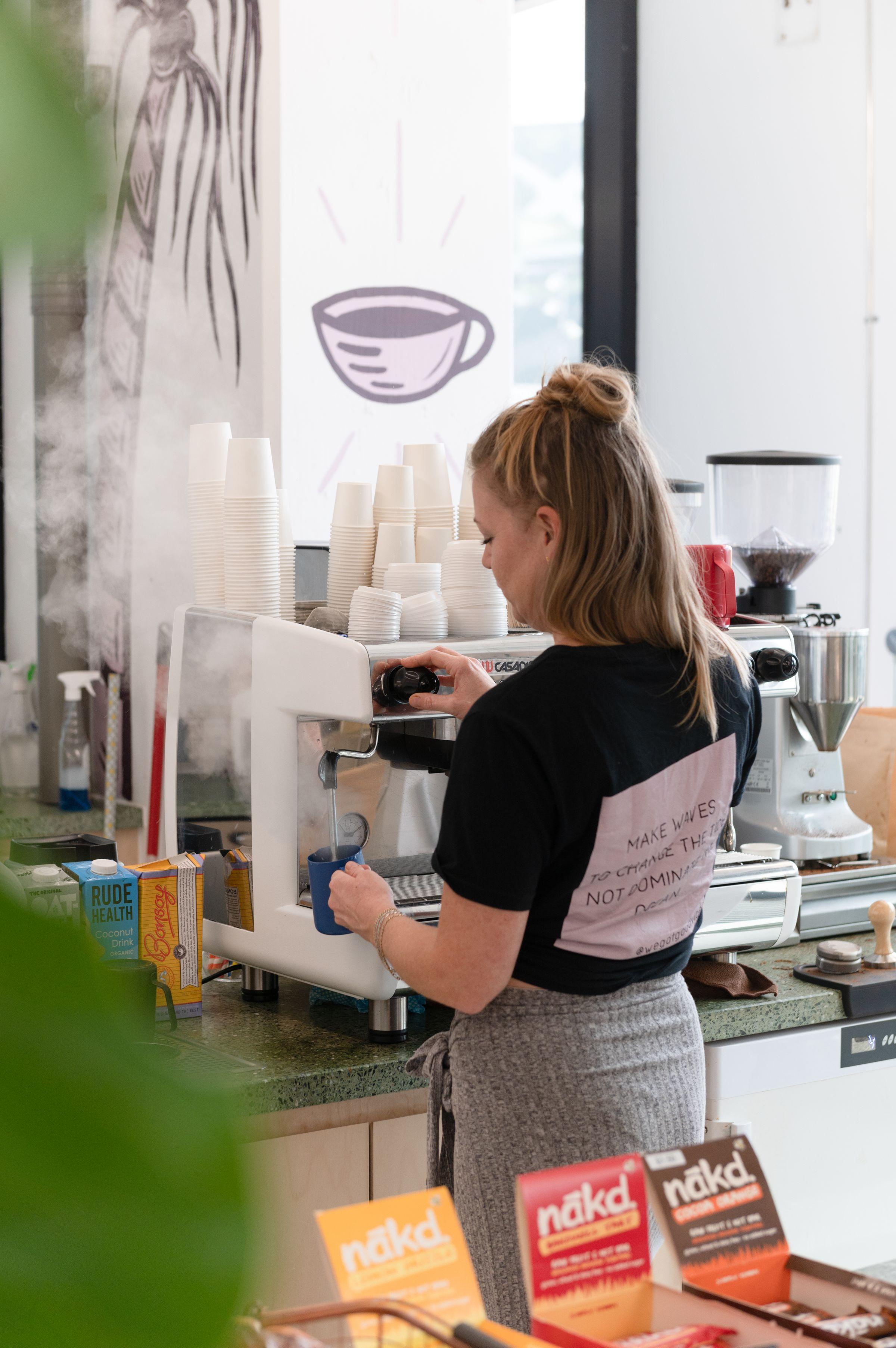 Woman making coffee with pro machine