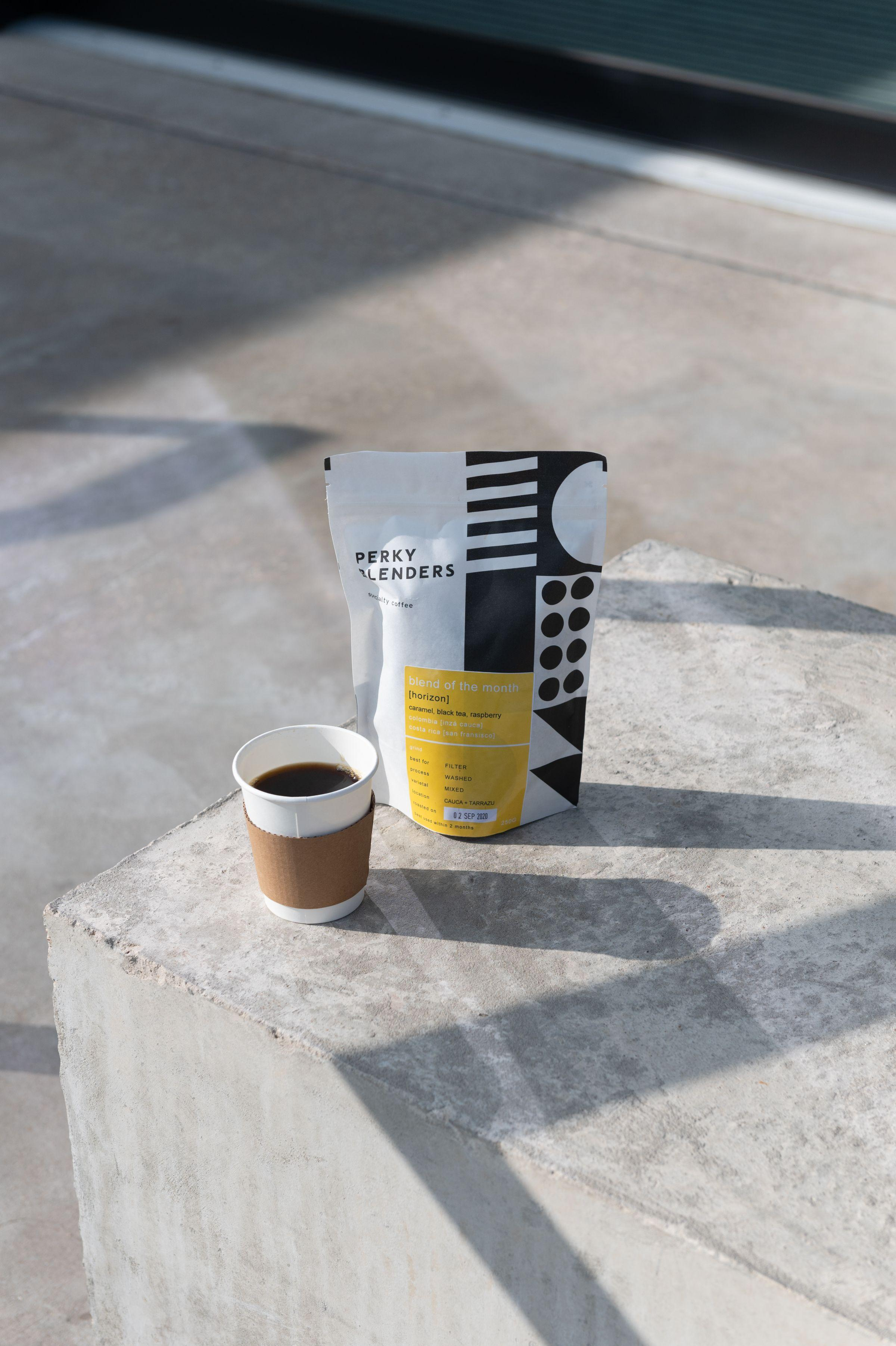 Coffee cup and bag of coffee