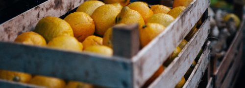 A wooden crate full of lemons