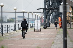 Loafly's white delivery bike seen driving off along the dockside