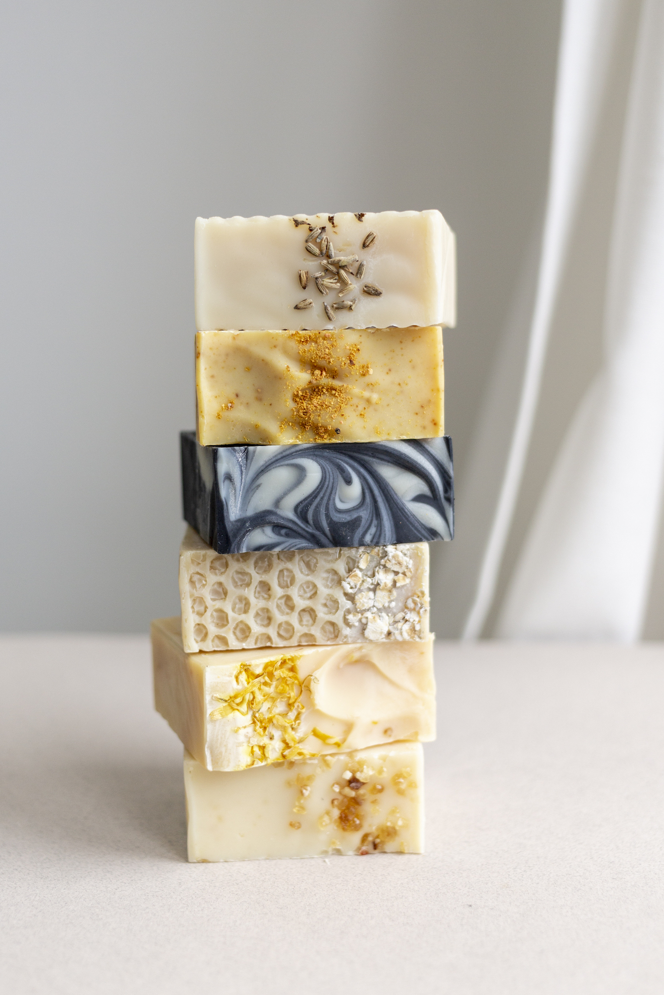 A stack of soaps in different colours