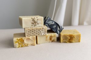 A stack of handmade soaps in different colours
