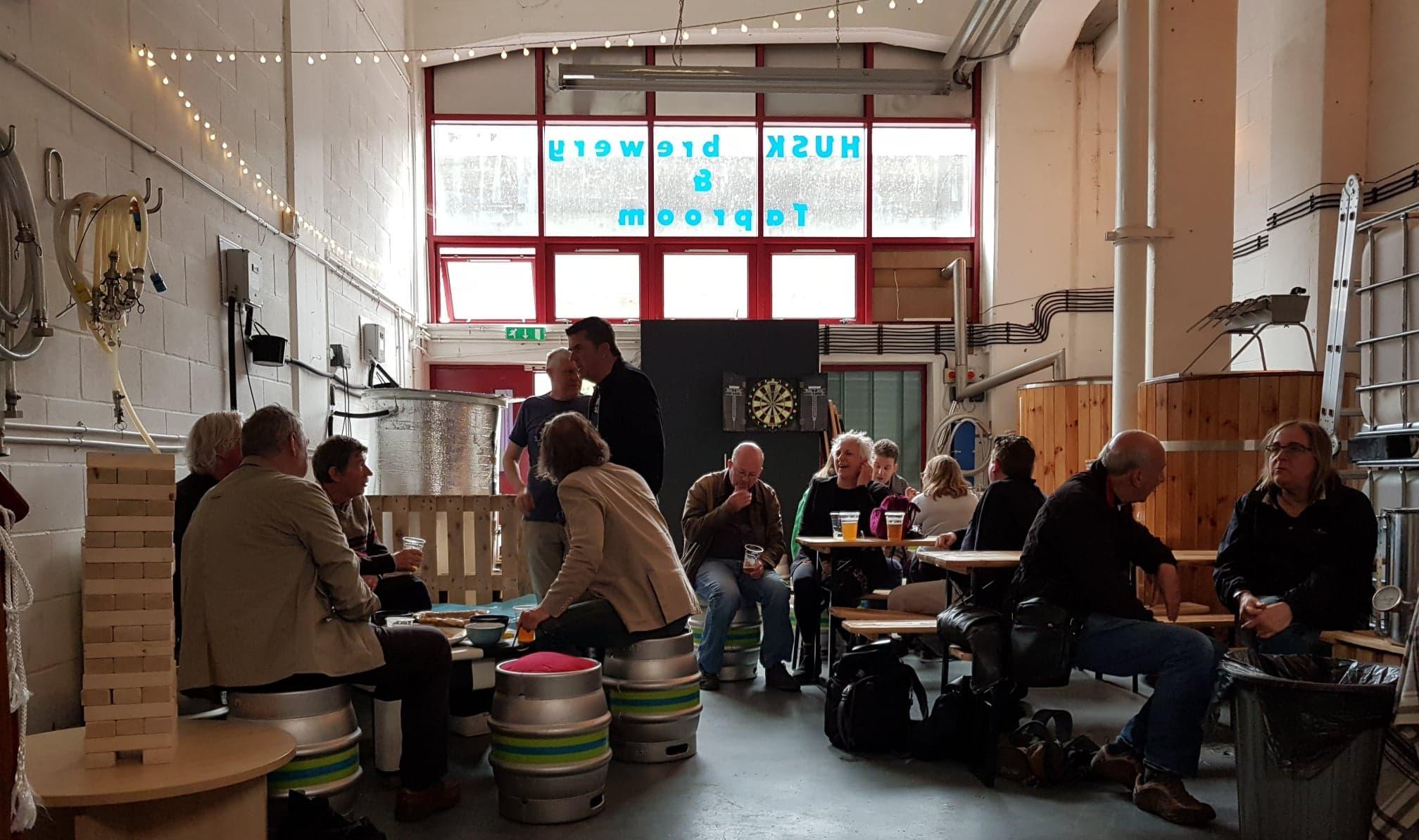 A crowd enjoying beer at Husk Brewing