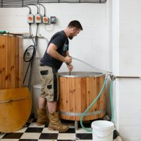 A man brewing beer at the Husk Brewery at the Royal Docks