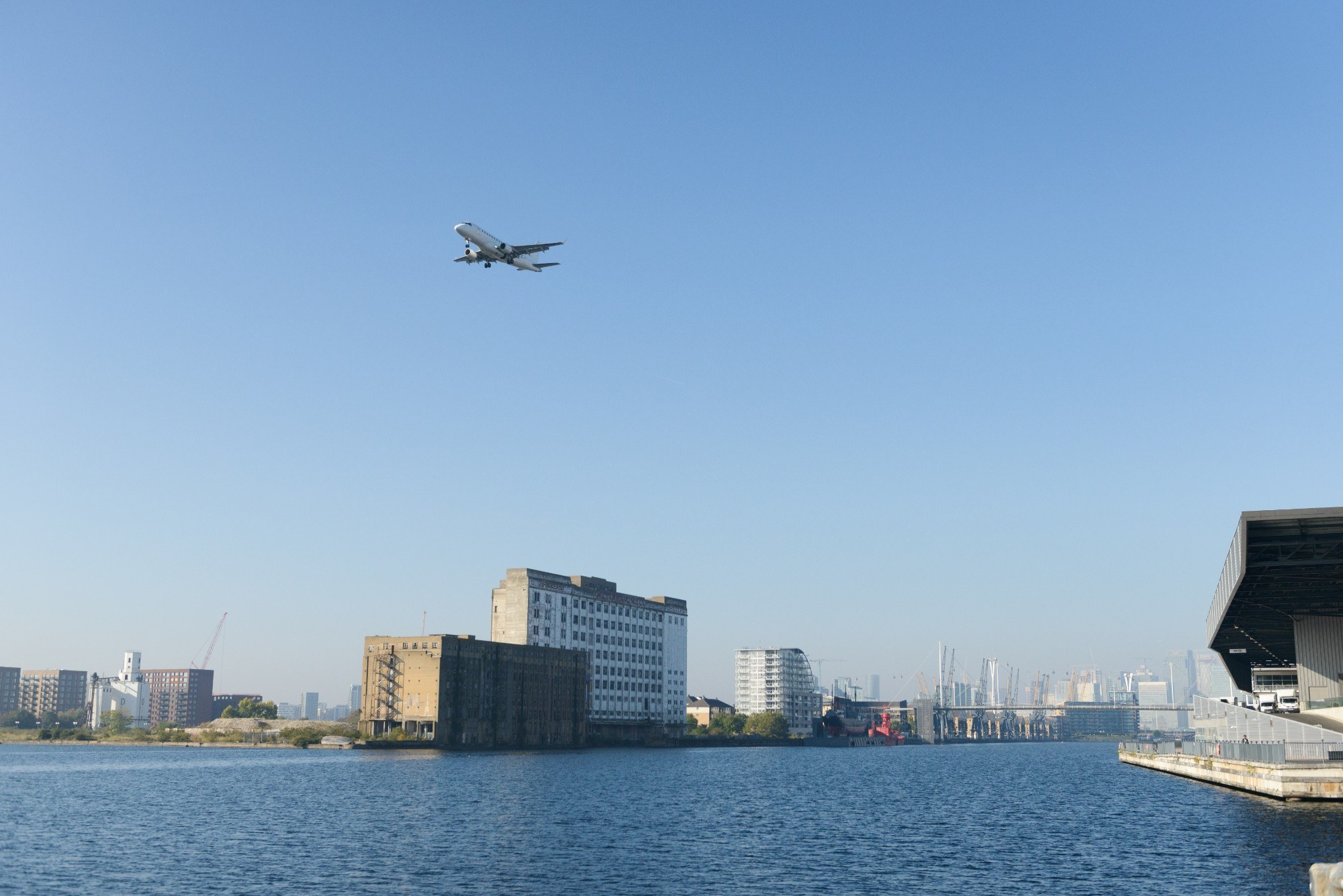 A plane flying over Millennium Mills