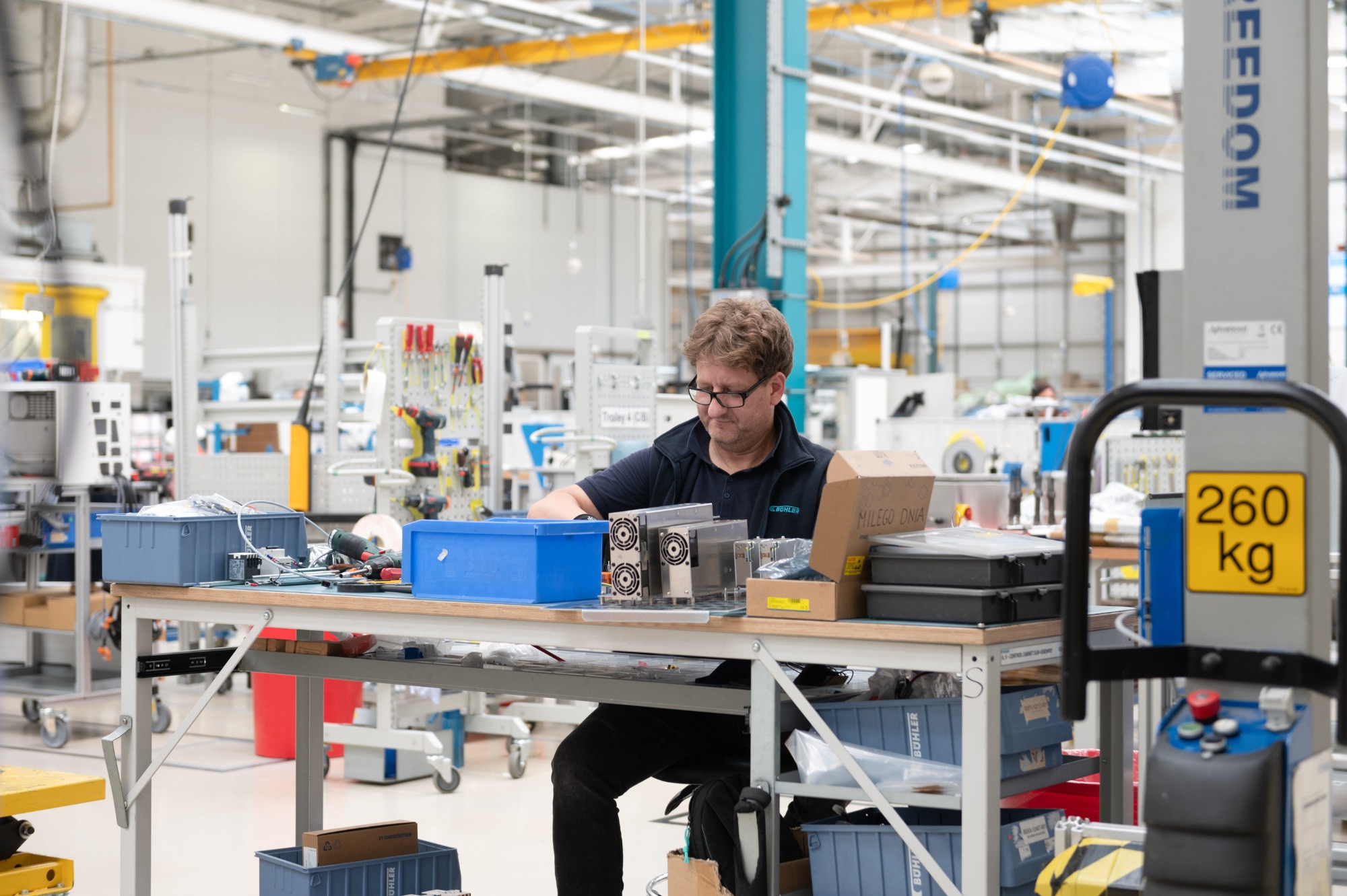 Buhler in the Royal Docks, man at a desk in a large industrial space