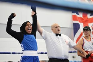 Woman cheering in boxing ring