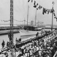 A historical photo of boats and crowds at the Royal Docks