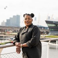 Photograph of Ona Brown in front of the Royal Docks