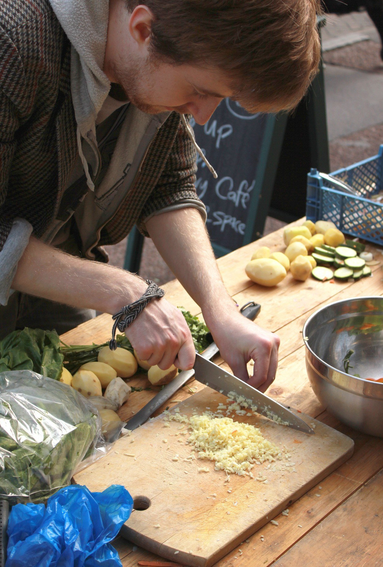 A man chopping vegetables on a chopping board