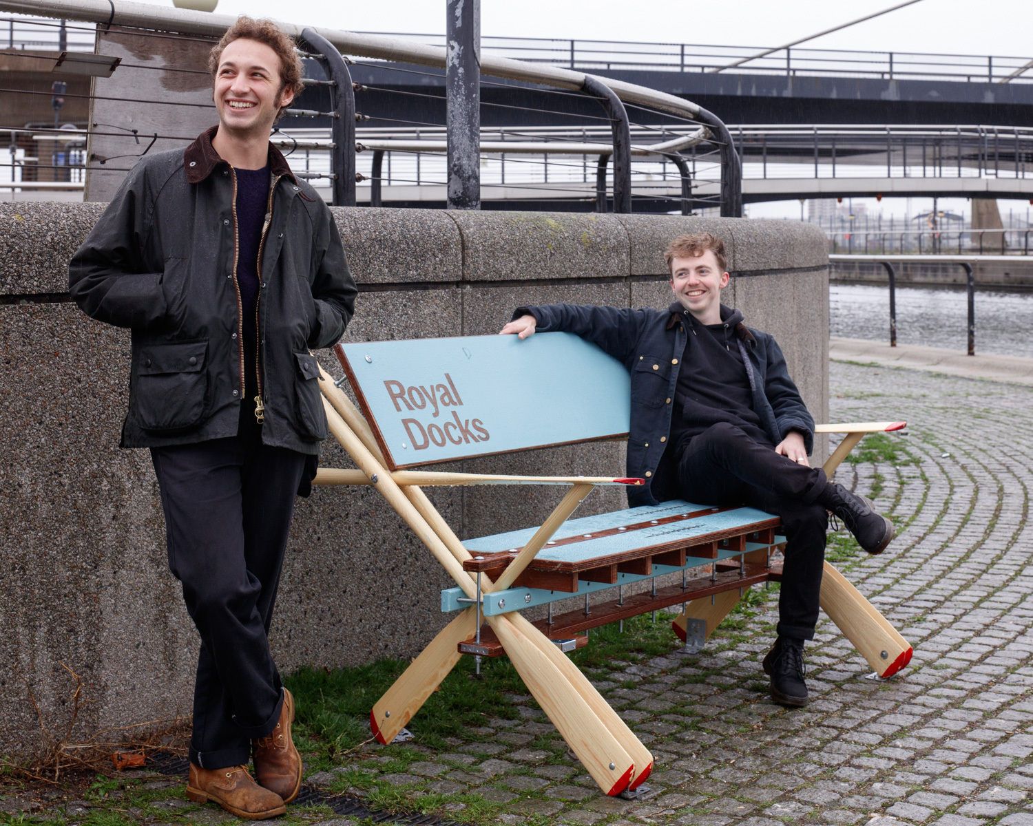 Standing by a bench at the Royal Docks