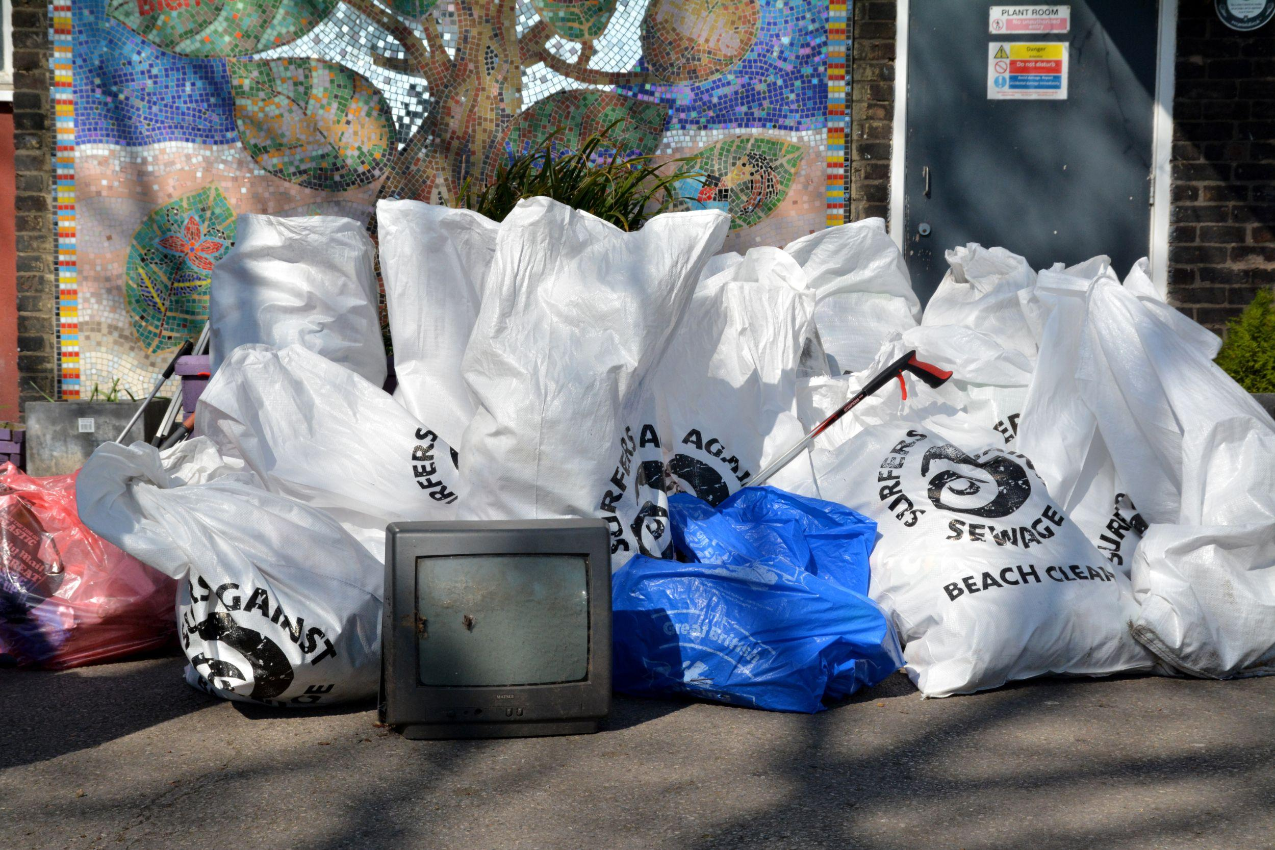 A collection of refuse sacks filled with litter