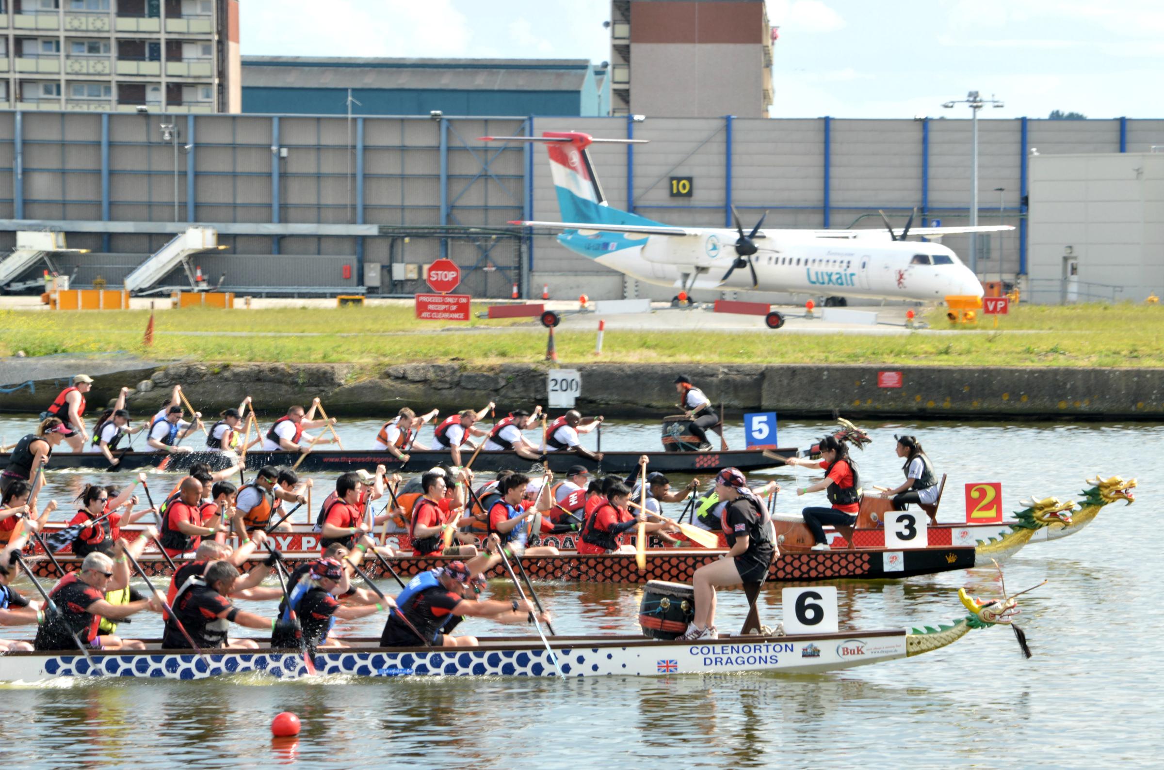 Three dragonboat teams racing at the Royal Docks