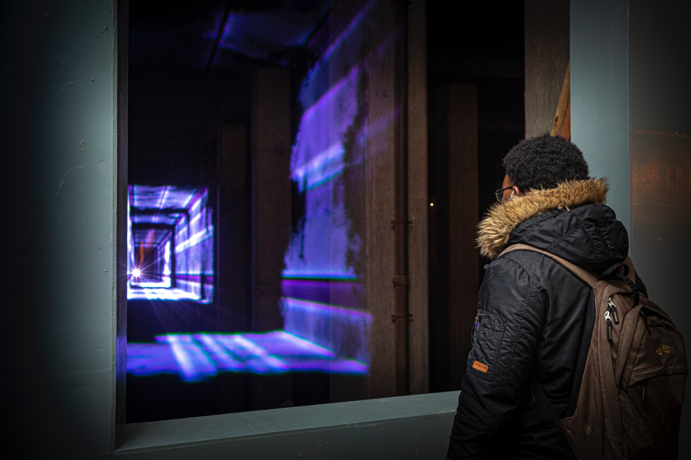A young man watching Presence by Marcus Lyall