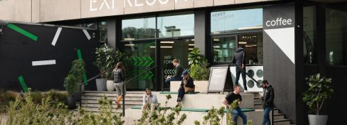 Expressway's dockside entrance on the side of Royal Victoria Dock, with coffee and planting