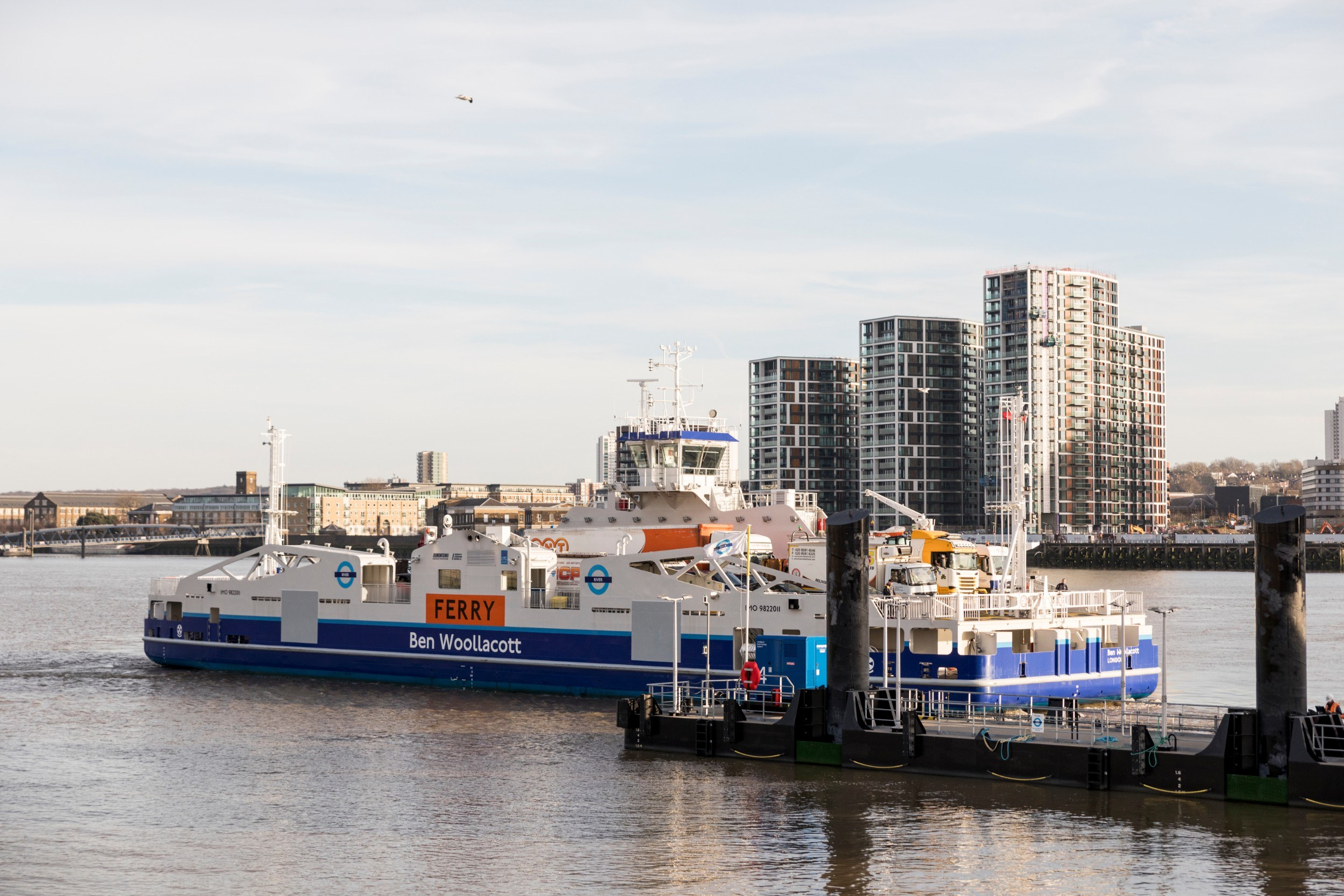 Ferry leaving its quay with Woolwich towers in the background