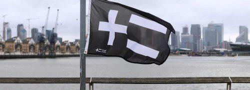 The Royal Docks logo on a flag