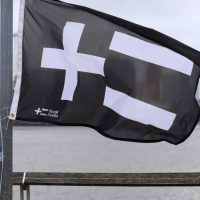 The Royal Docks logo on a flag