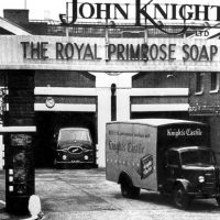 "A yard with vans and signage that reads, ""John Knight"""