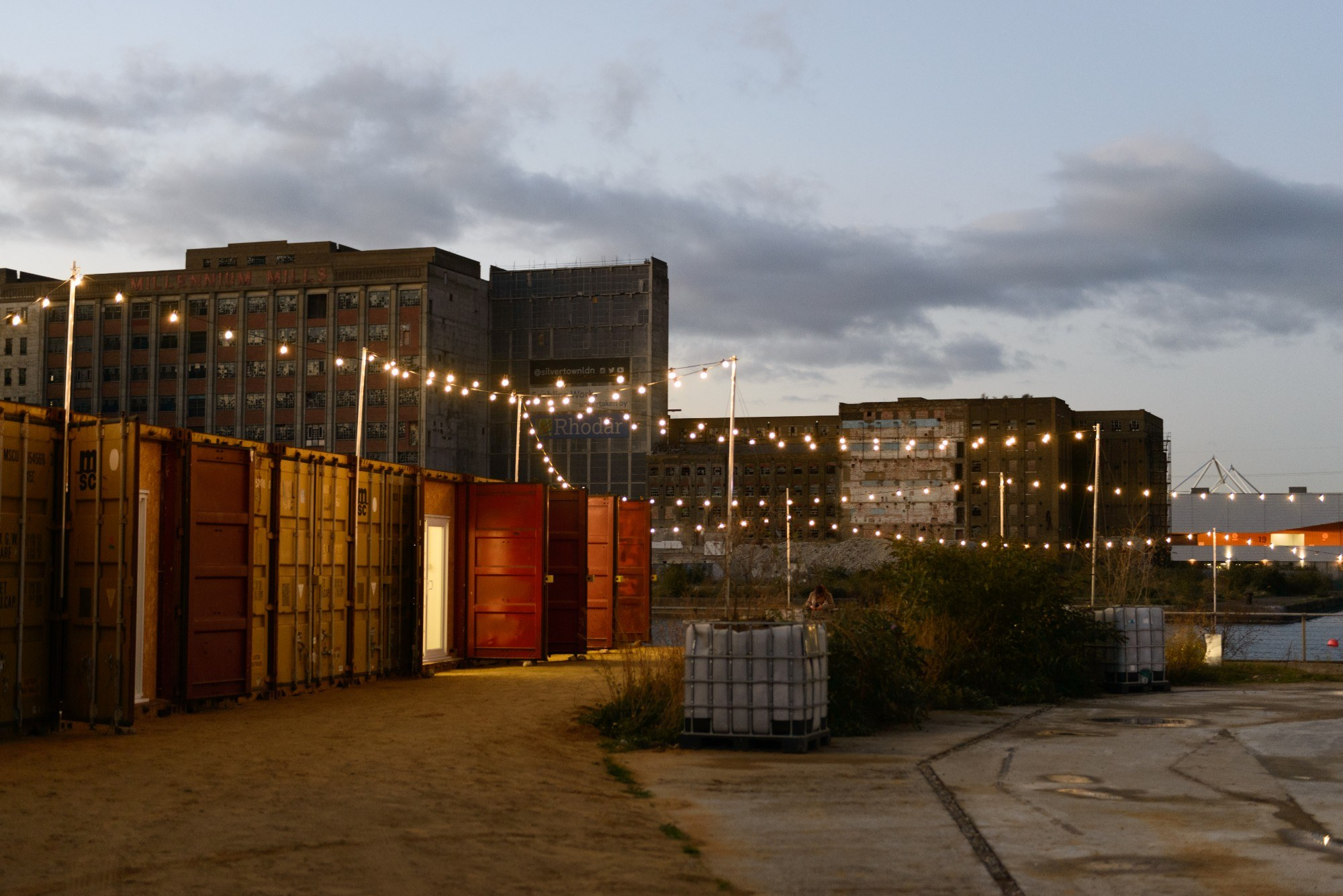 Shipping containers decorated with fairy lights