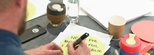 Man making notes on a round table