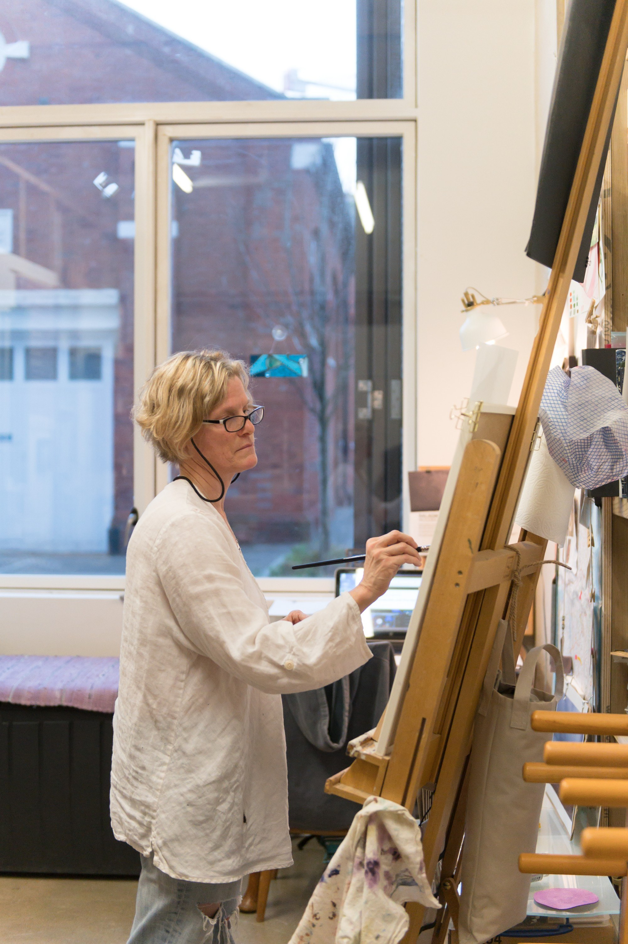 Artist painting on an easel