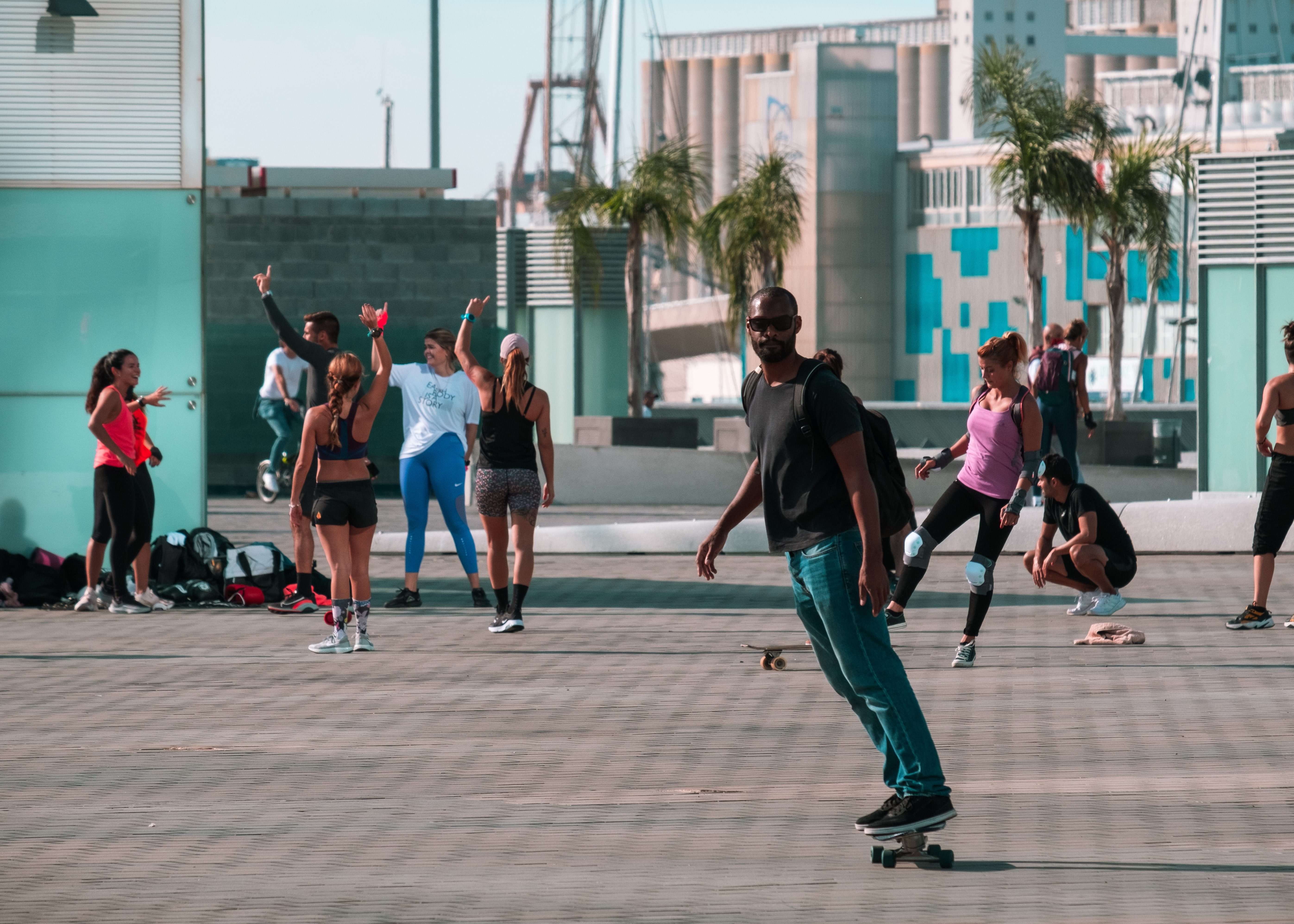 Skateboarder rolling down paved walkway in Barcelona