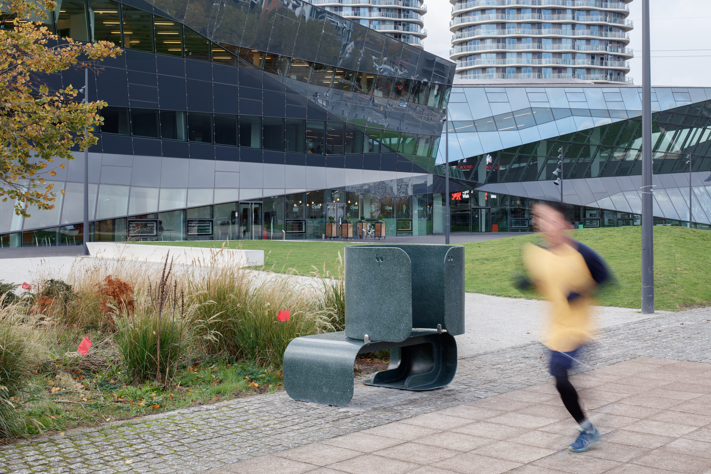 A jogger running past The Crystal