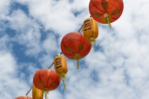 Red and yellow chinese lanterns against a blue sky